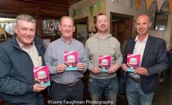 Committee members showing off the 2018 brochure